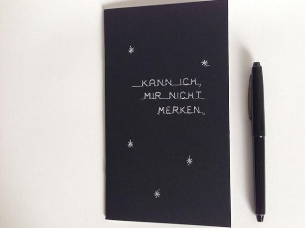 <span>Notizheft Merkhilfe</span><i>→</i>